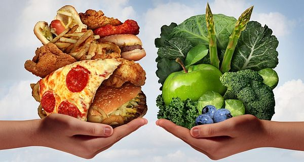 Hands with Junk and Healthy Food